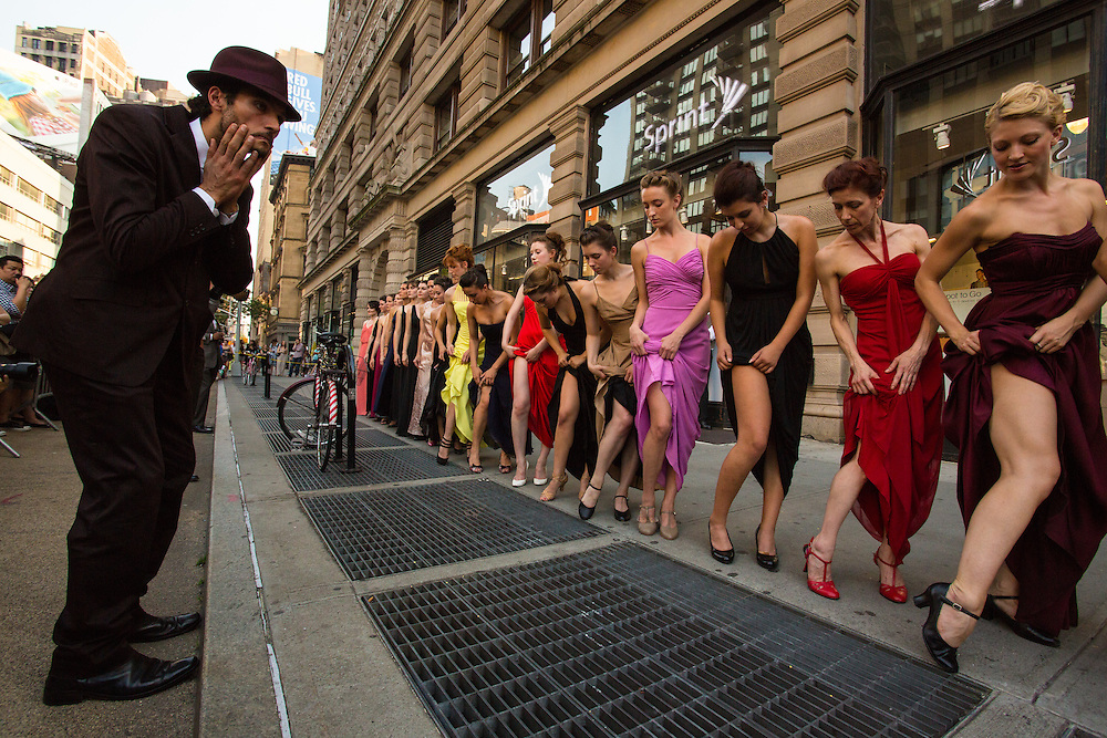 A man ogles as the women show their legs.
