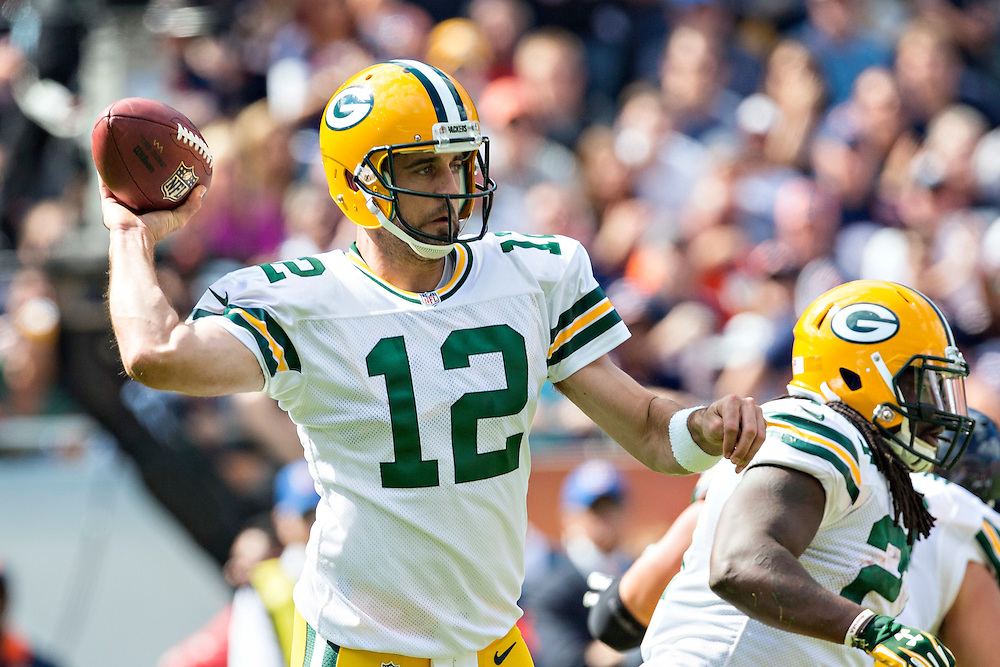 CHICAGO, IL - SEPTEMBER 13:  Aaron Rodgers #12 of the Green Bay Packers throws a pass against the Chicago Bears at Soldier Field on September 13, 2015 in Chicago, Illinois.  The Packers defeated the Bears 31-23.  (Photo by Wesley Hitt/Getty Images) *** Local Caption *** Aaron Rodgers