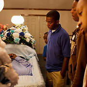 "The wake of Demetrius ""Butta"" Anderson, 18, in Greenwood, Mississippi on Thursday, November 4, 2010. Butta was shot and killed on October 27, 2010 by a man he had assaulted a year before. His older brother was shot and killed in 1996 and his cousin, Bianca Keys, was also 18 when she was murdered in 2009. Butta's girlfriend is pregnant, due in December."