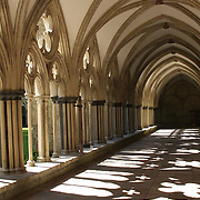 The cloister around the open green space at Salisbury cathedral, the largest medieval cathedral in England.