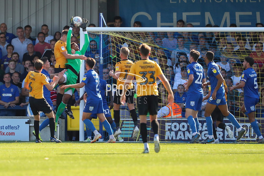 AFC Wimbledon goalkeeper Nathan Trott (1) saves ball and battles for possession during the EFL Sky Bet League 1 match between AFC Wimbledon and Bristol Rovers at the Cherry Red Records Stadium, Kingston, England on 21 September 2019.