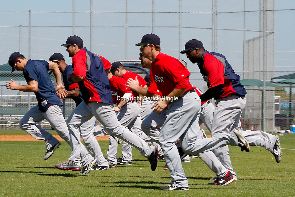 February 23, 2011; Fort Myers, FL, USA; Boston Red Sox players run sprint at the end of a spring training practice at the Player Development Complex.  Mandatory Credit: Derick E. Hingle