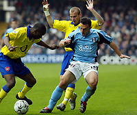 Photo. Chris Ratcliffe<br /> Fulham v Arsenal. FA Premiership. 09/05/2004<br /> Toure and Llungberg are tight in on Steed Malbranque of Fulham