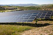 Array of photovoltaic solar panels in Mediterranean sunshine, near Alhama de Granada, Spain
