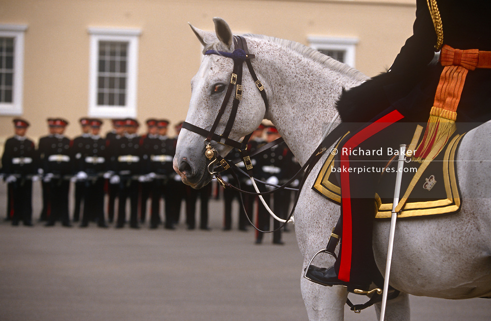 The Sovereigns passing-out parade at the Sandhurst Royal Military Academy, on 16th June 1996, at Sandhurst, England. The Royal Military Academy Sandhurst (RMAS), commonly known simply as Sandhurst, is the British Army officer initial training centre. Sandhurst is prestigious and has had many famous alumni including Sir Winston Churchill, King Abdullah II of Jordan, Sultan Qaboos of Oman and, more recently, Prince Harry and Prince William. All British Army officers, and many from elsewhere in the world, are trained at Sandhurst. RMA Sandhurst was formed in 1947, from a merger of the Royal Military Academy in Woolwich (which trained officers for the Royal Artillery and Royal Engineers from 1741 to 1939) and the Royal Military College at Sandhurst.