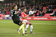 Macclesfield Town defender Miles Welch-Hayes challenged by the opponent during the EFL Sky Bet League 2 match between Salford City and Macclesfield Town at the Peninsula Stadium, Salford, United Kingdom on 23 November 2019.