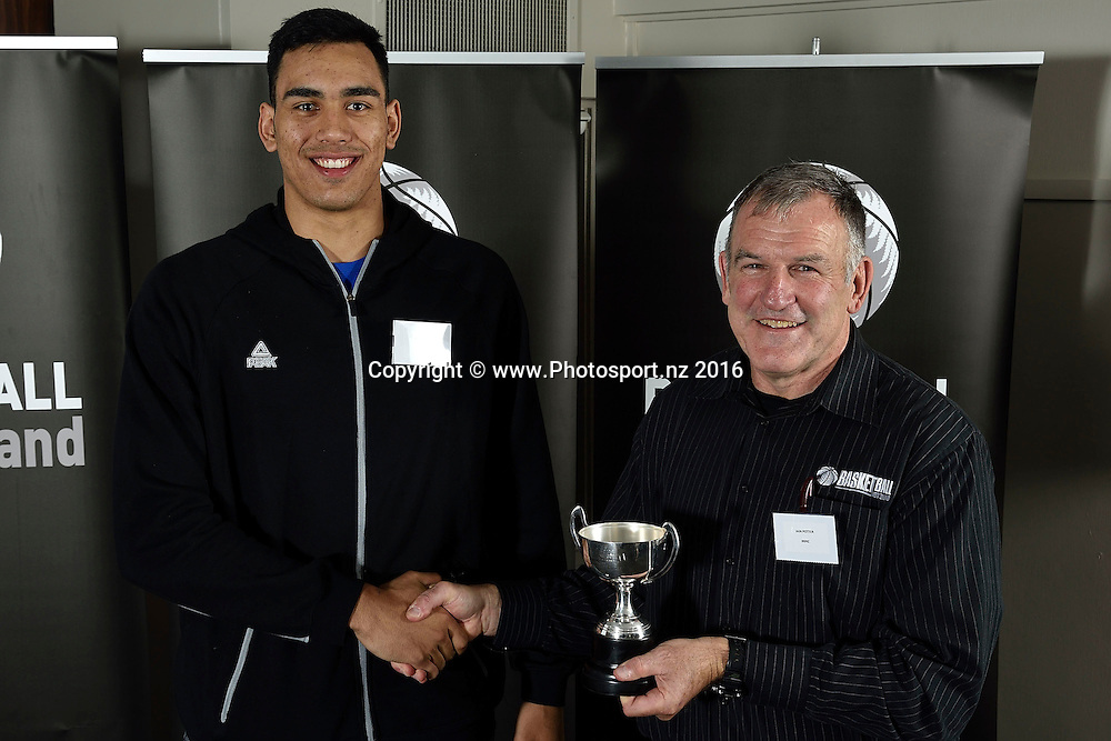 Tai Wynyard (L) receives the Ambassadors Trophy for Male Junior Player of the Year form Iain Potter during the Basketball New Zealand awards evening at the Mercure Hotel in Wellington on Friday the 20th of May 2016. Copyright Photo by Marty Melville / www.Photosport.nz