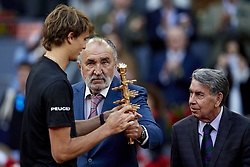 May 13, 2018 - Madrid, Madrid, Spain - Owner of the tournament Ion Tiriac (C) of Romania gives the trophy to Alexander Zverev (L) of Germany next to Director of the tournament Manolo Santana during day nine of the Mutua Madrid Open tennis tournament at the Caja Magica on May 13, 2018 in Madrid, Spain  (Credit Image: © David Aliaga/NurPhoto via ZUMA Press)