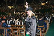 Heidi Hess celebrates at graduate commencement ceremonies. Photo by Ben Siegel