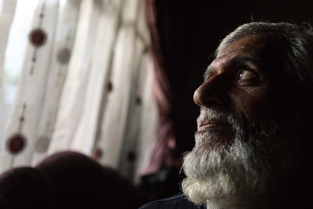 An elderly resident of the Al Thawra nieghborhood contemplates liberation in a house that contained nearly 100 civilians that had just been rescued by Iraqi forces. West Mosul, Iraq. Apr. 19, 2017. (Photo by Gabriel Romero ©2017)