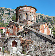 Church of Labova e Kryqit, or church of the Holy Cross, dedicated to St Mary, one of the oldest churches in Albania, mainly 13th century although with Byzantine foundations of 527-565 AD in the time of Emperor Justinian, Labova e Kryqit, Gjirokastra, Albania. The nave and aisle form a cruciform plan and the high central cupola is typically Byzantine. A narthex added later provides the principal entrance. The interior walls are covered with 9 levels of frescoes. Picture by Manuel Cohen