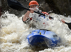 "Garrett Bentley of St. Louis, Missouri races in the K1 Men's Novice/Expert class on the slalom course of the 45th Annual Missouri Whitewater Championships. Bentley placed third in the class and second in the downriver K1 Men's Plastic (under 30 class). The Missouri Whitewater Championships, held on the St. Francis River at the Millstream Gardens Conservation Area, is the oldest regional whitewater slalom race in the United States. Heavy rain in the days prior to the competition sent water levels on the St. Francis River to some of the highest heights that the race has ever been run. Only expert classes were run on the flood level race course.Novices who chose to race were re-classified as ""novice experts"" to recognize their achievements."