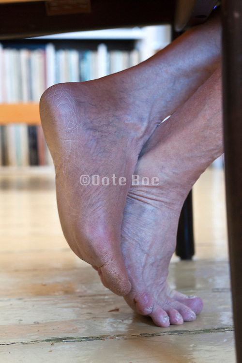 feet of person sitting casual at home