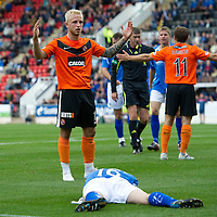 St Johnstone v Dundee United...27.08.11   SPL Week 5<br /> Johnny Russell pleads his innocence after kicking David Robertson in the face for a penalty<br /> Picture by Graeme Hart.<br /> Copyright Perthshire Picture Agency<br /> Tel: 01738 623350  Mobile: 07990 594431