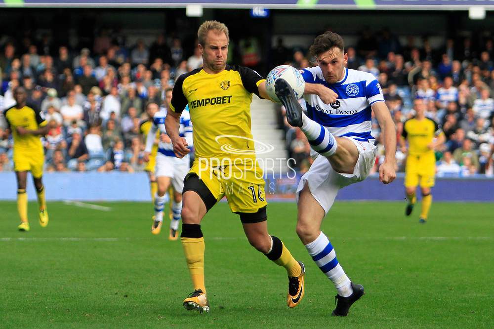 Queens Park Rangers defender Jack Robinson (18) controls the ball from Burton Albion striker Luke Varney (16) during the EFL Sky Bet Championship match between Queens Park Rangers and Burton Albion at the Loftus Road Stadium, London, England on 23 September 2017. Photo by Richard Holmes.