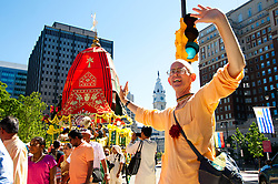 Parade of Chariots, pulled in procession by participant over Benjamin Franklin Parkway, in the direction of Eakins Oval, in Philadelphia, PA, on September 23, 2017. Participating in the parade are members of International Society For Krishna Consciousness as well as locals representing the Indian culture and heritage.