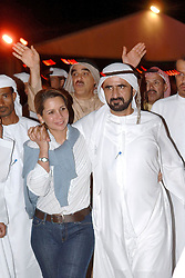 File photo - Dubai's Crown Prince Sheikh Mohammed Bin Rashed Al Maktoum and his wife Princess Haya Bint Al-Hussein (of Jordan) attend the 'Arabian Night' desert party, two days before the Dubai World Cup horse race, in Dubai on March 24, 2005. The younger wife of the ruler of Dubai, the billionaire race horse owner Sheikh Mohammed bin Rashid al-Maktoum, is believed to be staying in a town house near Kensington Palace after fleeing her marriage. Princess Haya bint al-Hussein, 45, has not been seen in public for weeks. One half of one of the sporting world's most celebrated couples, she failed to appear at Royal Ascot last month with her husband. Photo by Ammar Abd Rabbo/ABACAPRESS.COM