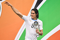 Edinson Cavani of Uruguay national football team poses with his trophy after defeating Wales national football team in their final match during the 2018 Gree China Cup International Football Championship in Nanning city, south China's Guangxi Zhuang Autonomous Region, 26 March 2018.<br /> <br /> Uruguay won the final by 1-0 against Wales and claimed the title of the event.