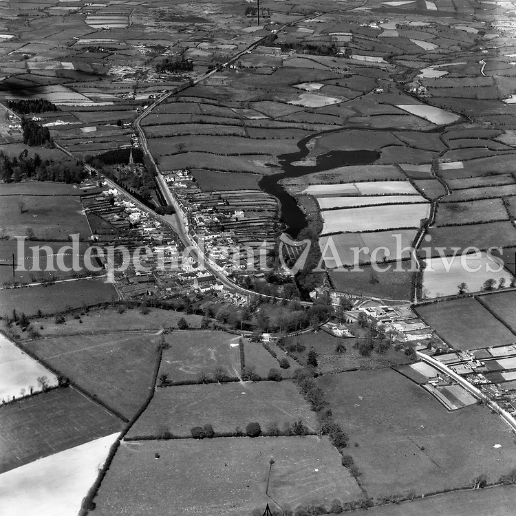 A436 Virginia.   01/01/54. (Part of the Independent Newspapers Ireland/NLI collection.)<br /> <br /> <br /> These aerial views of Ireland from the Morgan Collection were taken during the mid-1950's, comprising medium and low altitude black-and-white birds-eye views of places and events, many of which were commissioned by clients. From 1951 to 1958 a different aerial picture was published each Friday in the Irish Independent in a series called, 'Views from the Air'.The photographer was Alexander 'Monkey' Campbell Morgan (1919-1958). Born in London and part of the Royal Artillery Air Corps, on leaving the army he started Aerophotos in Ireland. He was killed when, on business, his plane crashed flying from Shannon.