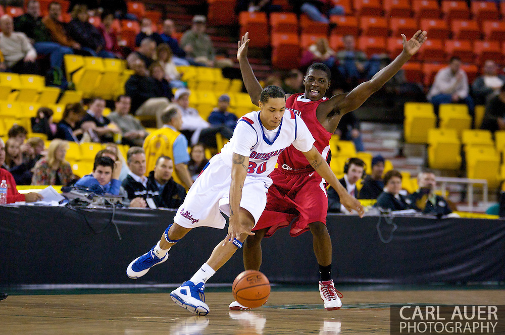 November 27, 2008: Louisiana Tech's David Jackson (30) tries to get around the defense of Seattle University guard Chris Gweth (15) in the opening round of the 2008 Great Alaska Shootout at the Sullivan Arena