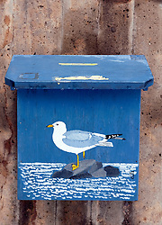 Wooden mailbox with seagull painting in village of fiskebackskil on Bohuslan coast in Sweden