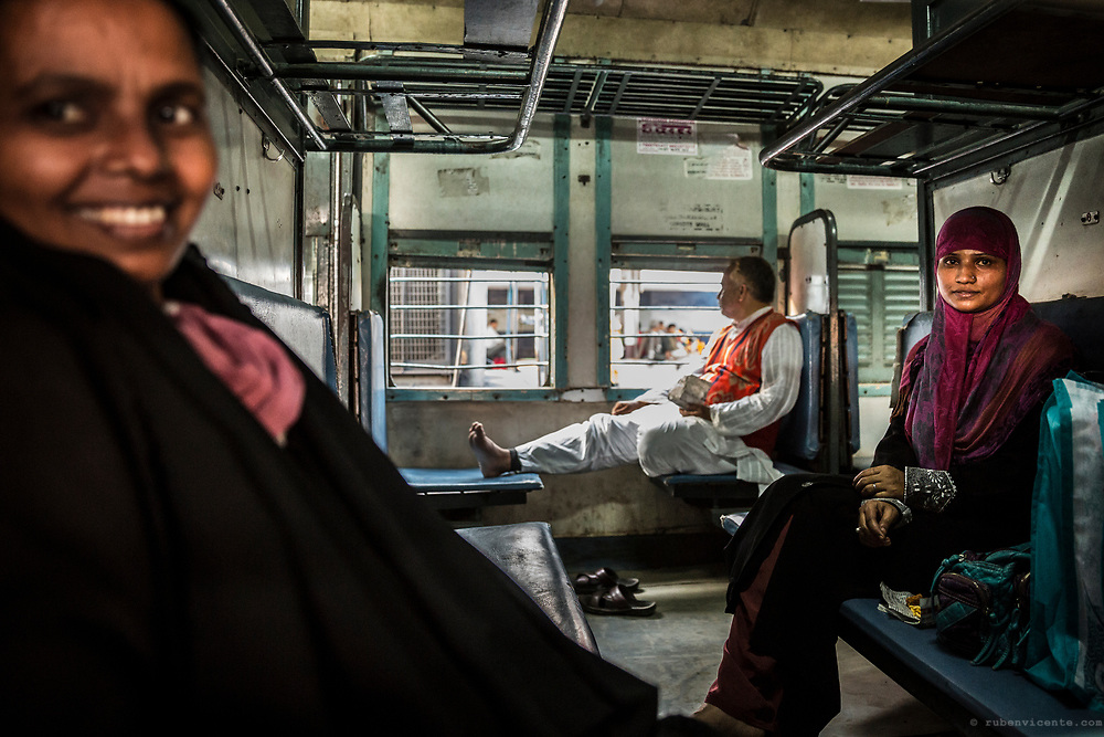 Women inside the train. Varanasi, India