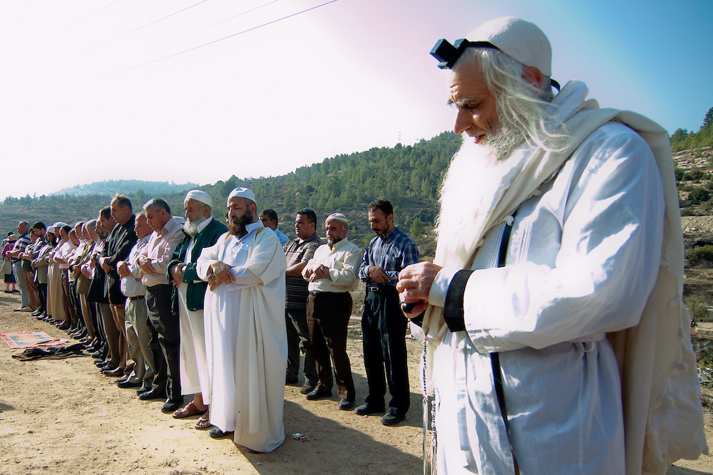 A group of Jews Moslims and Christians gathered on November 11 2010 in Chinya spring near Jerusalem and prayed together for god asking for rain.  Photo by Oren Nahshon.