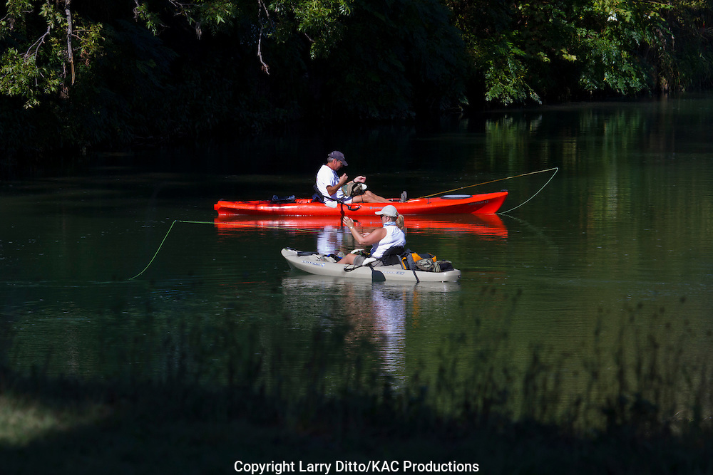 Fly fishing from kayaks on the South Llano River near Junction, Texas, autumn
