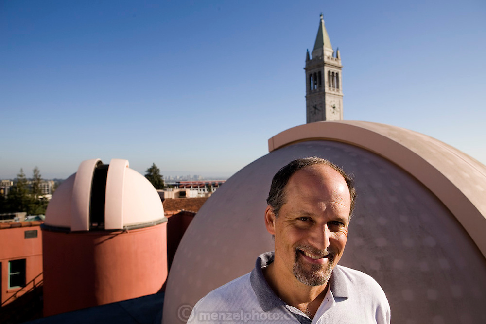 Astronomer Geoff Marcy on the roof of Cambell Hall at UC Berkeley (California) with 14 inch telescopes. Marcy and his team have detected a large number of exoplanets using data collected from large telescopes at other sites.  Exoplanets & Planet Hunters