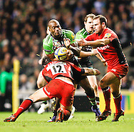 Picture by Andrew Tobin/Focus Images Ltd. 07710 761829. .27/12/11. Ugo Monye (11) of Harlequins is tackled by Brad Barritt (12) of Saracens and Charlie Hodgson (10) of Saracens during the Aviva Premiership match between Harlequins and Saracens at Twickenham Stadium, London.