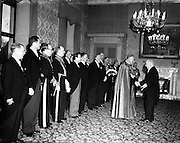 01/01/1953<br /> 01/01/1953<br /> 01 January 1953<br /> The Diplomatic Corps in Ireland call on President Sean T. O'Kelly at Aras an Uachtarain for the New Years Greeting ceremony. T Papal Nuncio, Most Rev. Dr. Gerald O'Hara greeted by the President.