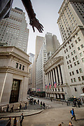 The hand of the George Washington Statue is seen atop of the New York Stock Exchange, NYSE Euronext on Wall Street in New York.