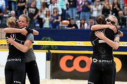 13.07.2014, Beach Village, Gstaad, SUI, FIVB Beach Volleyball Grand Slam Gstaad, im Bild Ilka Semmler, Karla Borger, Katrin Holtwick, Britta Buethe (GER) umarmen sich nach dem Finale // during the FIVB Beach Volleyball Grand Slam Gstaad at the Beach Village in Gstaad, Switzerland on 2014/07/13. EXPA Pictures © 2014, PhotoCredit: EXPA/ Freshfocus/ Claude Diderich<br /> <br /> *****ATTENTION - for AUT, SLO, CRO, SRB, BIH, MAZ only*****