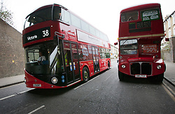 © licensed to London News Pictures. London, UK 27/02/2012. A new Routemaster bus goes past an old Routemaster bus. The old bus carried a protest against fare rises. London's newly designed hop-on, hop-off double decker bus services begin today 27th February 2012 as the first bus leaves Hackney Bus Garage this morning. Photo credit: Tolga Akmen/LNP