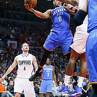 21 December 2015: Oklahoma City Thunder guard Russell Westbrook (0) goes for the layup past Los Angeles Clippers center DeAndre Jordan (6) during the Oklahoma City Thunder 100-99 victory over the Los Angeles Clippers, at the Staples Center, Los Angeles, California, USA.