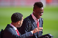Mario Balotelli of Liverpool (right) shares a joke with Raheem Sterling of Liverpool (left) as they arrive at the stadium before the Barclays Premier League match at Anfield, Liverpool<br /> Picture by Russell Hart/Focus Images Ltd 07791 688 420<br /> 22/03/2015