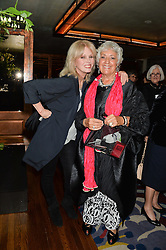 Left to right, JOANNA LUMLEY and GEMMA LEVINE at a party to celebrate the publication on 'Just One More - A Photographers Memoir' by Gemma Levine held at 34, South Audley Street, London on 7th April 2014.