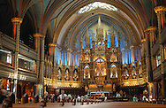 Visitors make photos and pray in the Basilique Notre-Dame de Montreal in Vieux-Montreal, the historic old city center, of Montreal, Canada. (Photo by Phelan M. Ebenhack)