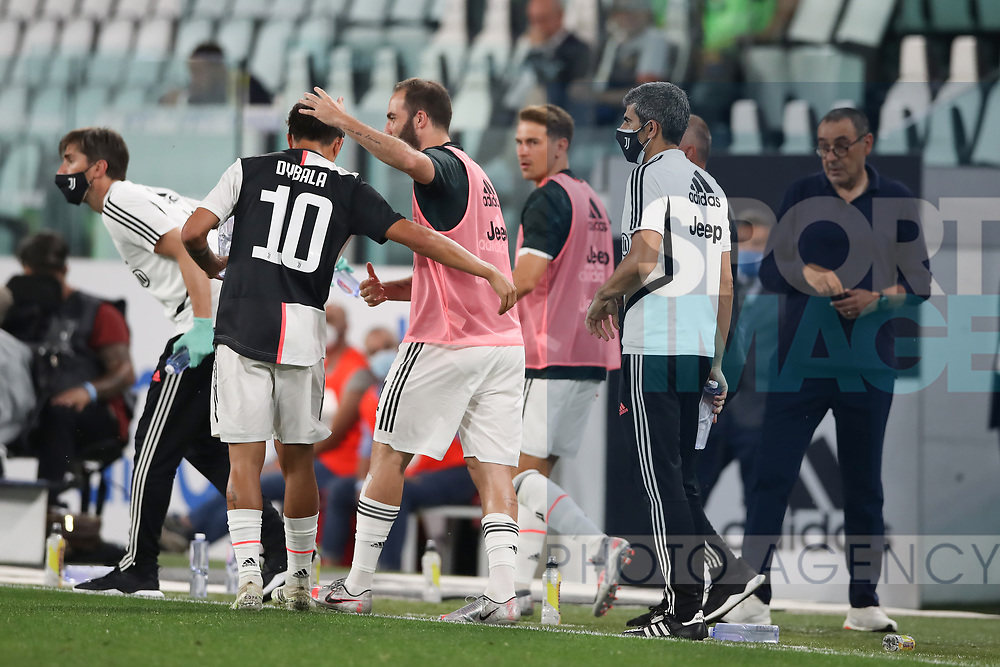 Juventus's Argentinian striker Paulo Dybala celebrates with Argentinian striker Gonzalo Higuain after scoring to give the side a 1-0 lead during the Serie A match at Allianz Stadium, Turin. Picture date: 26th June 2020. Picture credit should read: Jonathan Moscrop/Sportimage