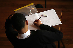 File photo dated 02/03/12 of a teenager taking a exam. Around three in 10 teenage boys admit they have cried because they are stressed out by exams, according to a poll.
