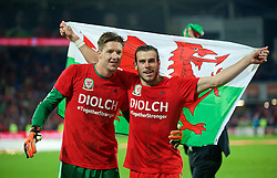 CARDIFF, WALES - Tuesday, October 13, 2015: Wales' goalkeeper Wayne Hennessey and Gareth Bale celebrate qualifying for the finals following a 2-0 victory over Andorra during the UEFA Euro 2016 qualifying Group B match at the Cardiff City Stadium. (Pic by Ian Cook/Propaganda)