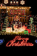 """Christmas display on 12th Avenue in Brooklyn's Dyker Height's neighbrohood. """"Merry Christmas"""" is written out in lights on the front lawn."""