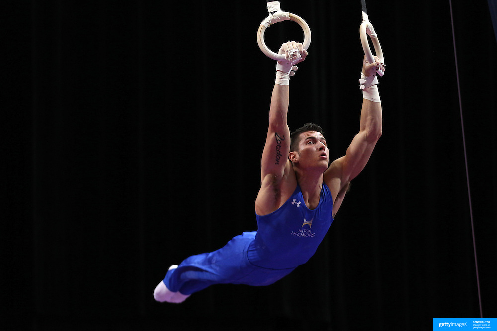 Alexander Naddour, Queen Creek, Arizpna, in action on the Still Rings during the Senior Men Competition at The 2013 P&G Gymnastics Championships, USA Gymnastics' National Championships at the XL, Centre, Hartford, Connecticut, USA. 16th August 2013. Photo Tim Clayton
