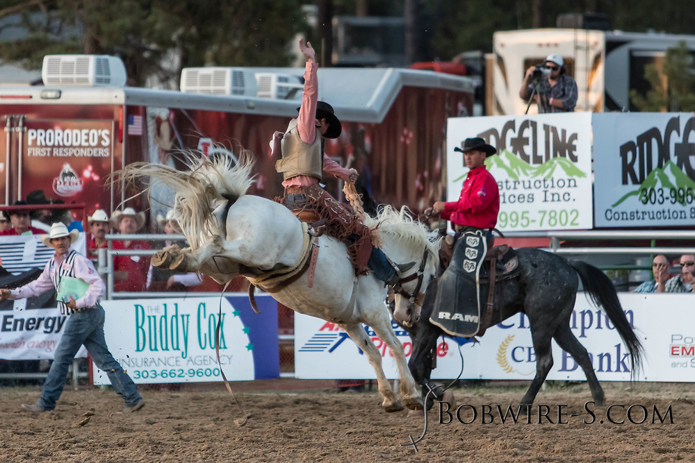 Saddle bronc rider XXXX rides Summit Pro Rodeo's XXXX in the second performance of the Elizabeth Stampede on Saturday, June 2, 2018.