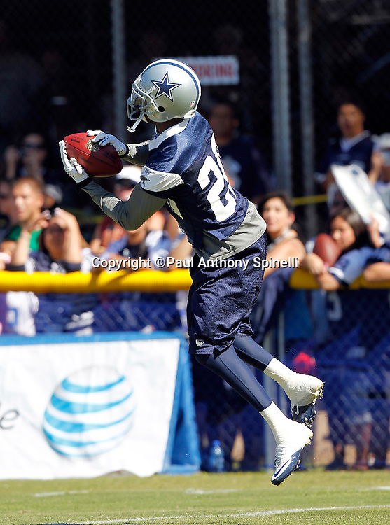 Dallas Cowboys safety Alan Ball (20) leaps to catch a pass during NFL football training camp on Wednesday, August 18, 2010 in Oxnard, California. (©Paul Anthony Spinelli)