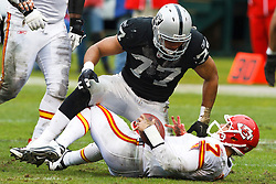 November 7, 2010; Oakland, CA, USA;  Oakland Raiders defensive end Matt Shaughnessy (77) tackles Kansas City Chiefs quarterback Matt Cassel (7) after a run during the first quarter at Oakland-Alameda County Coliseum.