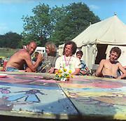 Bill & Stewart at a round table, at Glastonbury, 1989.