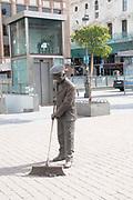 Street cleaner statue, Plaza Jacinto Benavente, Madrid, Spain