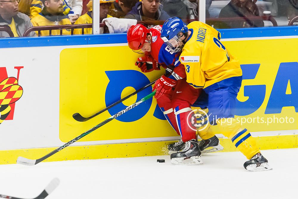 140104 Ishockey, JVM, Semifinal,  Sverige - Ryssland<br /> Icehockey, Junior World Cup, SF, Sweden - Russia.<br /> Anton Slepyshev, (RUS), Robin Norell, (SWE).<br /> Endast f&ouml;r redaktionellt bruk.<br /> Editorial use only.<br /> &copy; Daniel Malmberg/Jkpg sports photo