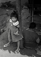 Young Karen girl and her mother in the Lep Per Her camp.  <br />